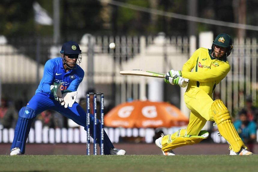 Australian cricketer Usman Khawaja (right) plays a shot during the third one-day international cricket match between India and Australia at the Jharkhand State Cricket Association International Cricket Stadium, in Ranchi, on March 8, 2019.