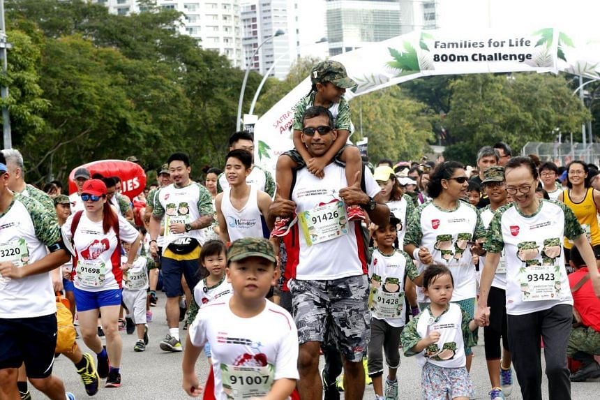 Parents and children running together at the Safra Singapore Bay Run and Army Half Marathon on Aug 20, 2017.