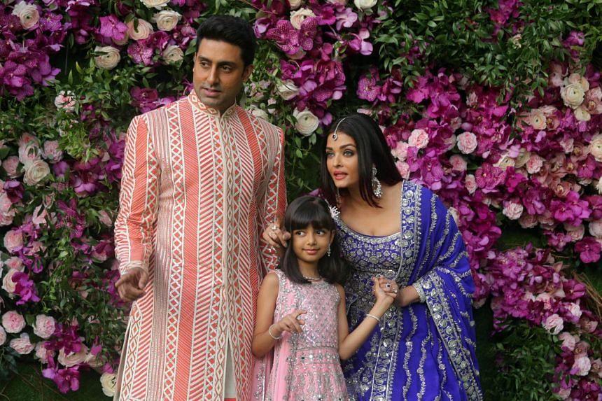 (From left) Actor Abhishek Bachchan, his wife actress Aishwarya Rai and their daughter, Aaradhya, pose at the wedding ceremony of Akash Ambani, son of Chairman of Reliance Industries Mukesh Ambani, at Bandra-Kurla Complex in Mumbai.