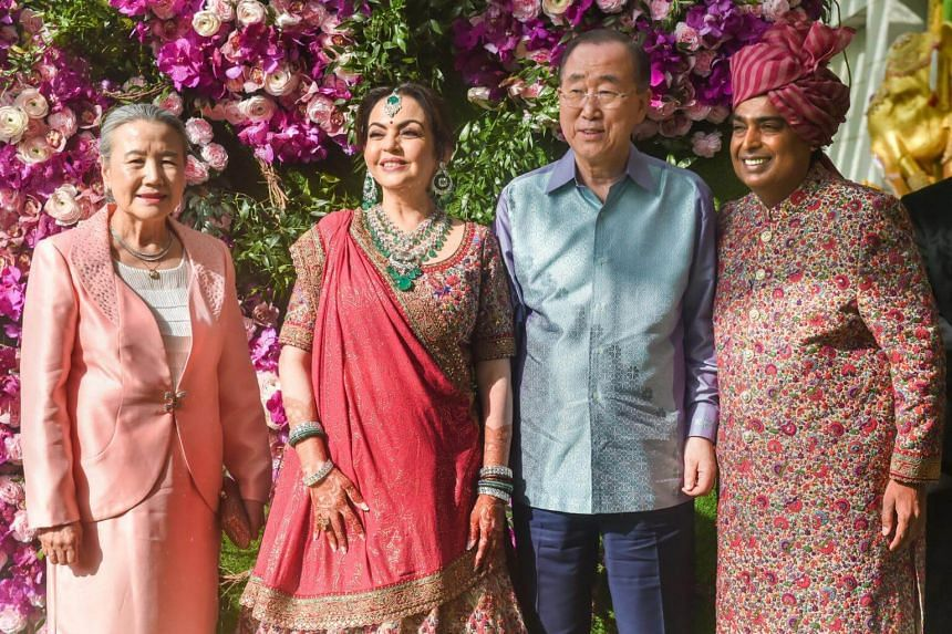 Former United Nations chief Ban Ki-Moon (second, right) and his wife Yoo Soon-taek (left) with Chairman of Reliance Industries Mukesh Ambani (right) and his wife Neeta Ambani at the wedding ceremony of their son Akash, at Bandra-Kurla Complex in Mumb