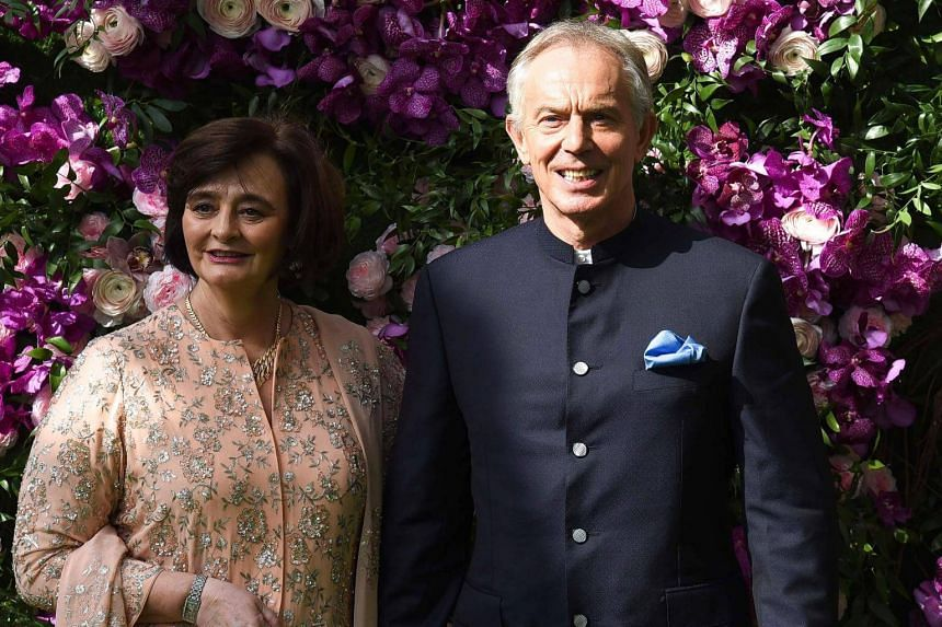 Former British prime minister Tony Blair (right) and his wife Cherie Blair attend the wedding ceremony of Akash Ambani, son of Indian businessman Mukesh Ambani, in Mumbai, on March 9, 2019.