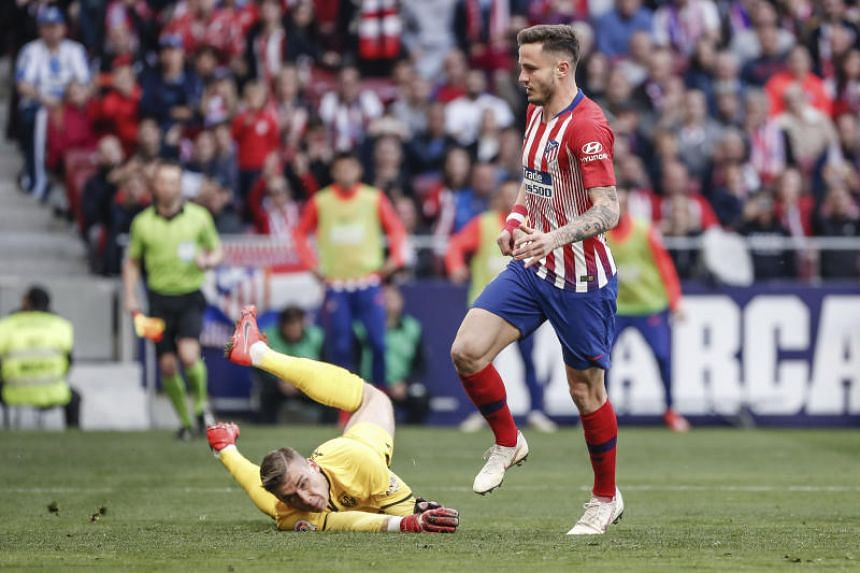 Atletico Madrid's Saul Niguez (right) scores his side's first goal during the Spanish Primera Division soccer match between Atletico Madrid and Leganes at the Wanda Metropolitano stadium on March 9, 2019.