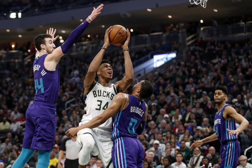3e89553206a Milwaukee Bucks forward Giannis Antetokounmpo shoots against Charlotte  Hornets forward Miles Bridges during their NBA game