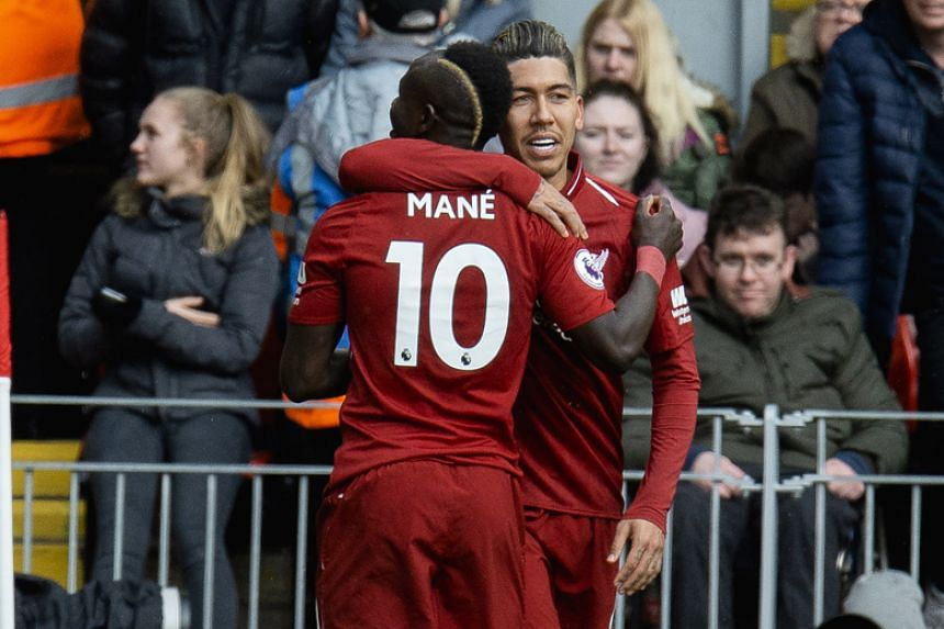 Liverpool's Sadio Mane is congratulated by Roberto Firmino after scoring a goal during the English Premier League soccer against Burnley at Anfield in Liverpool on March 10, 2019.