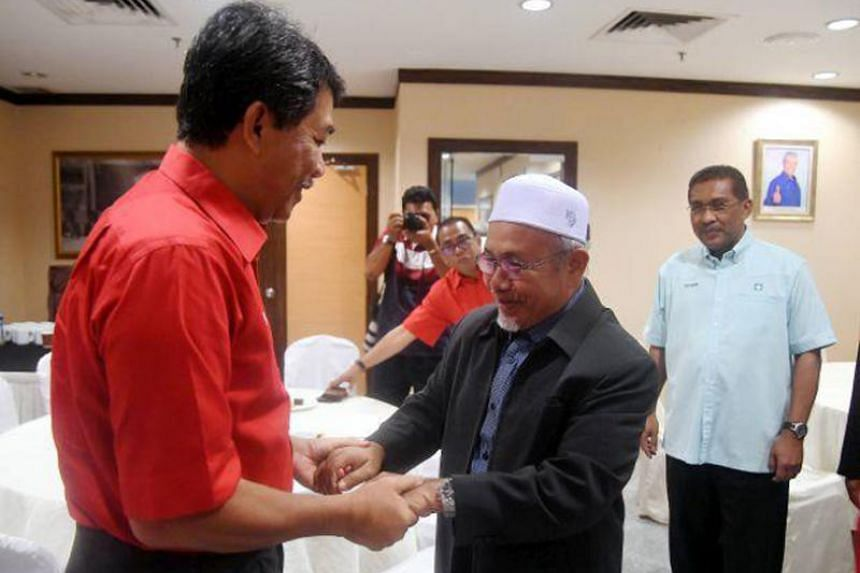 Umno deputy president Mohamad Hassan (left) with Parti Islam SeMalaysia deputy president before their meeting at the Umno headquarters in Kuala Lumpur on March 5, 2019.
