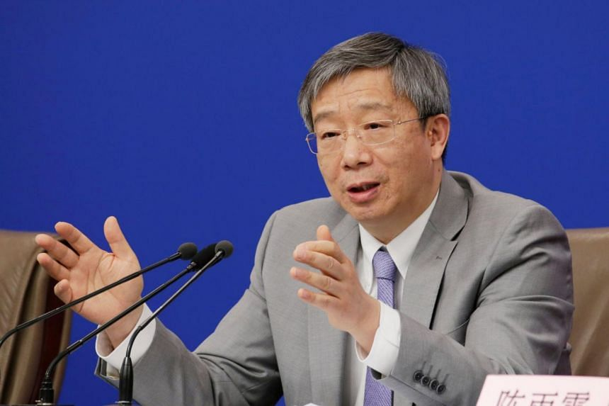 Yi Gang, the governor of the People's Bank of China, attends a news conference during the ongoing session of the National People's Congress in Beijing, China March 10, 2019.