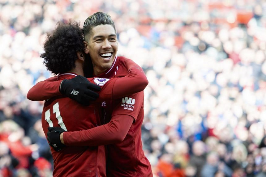 Liverpool's Roberto Firmino (right) celebrates scoring against Burnley.