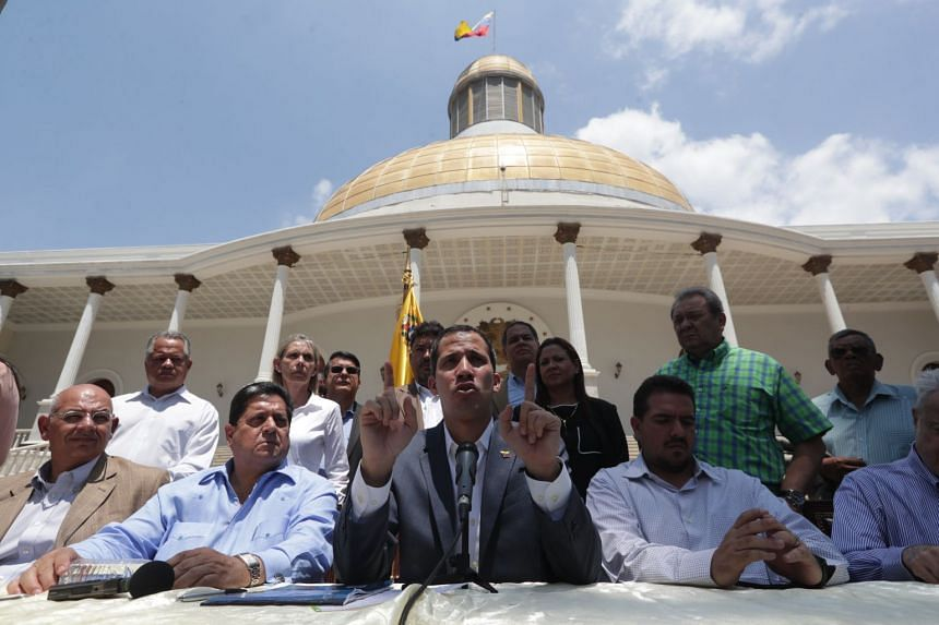 Opposition politician Juan Guaido speaks during a press conference in Caracas.