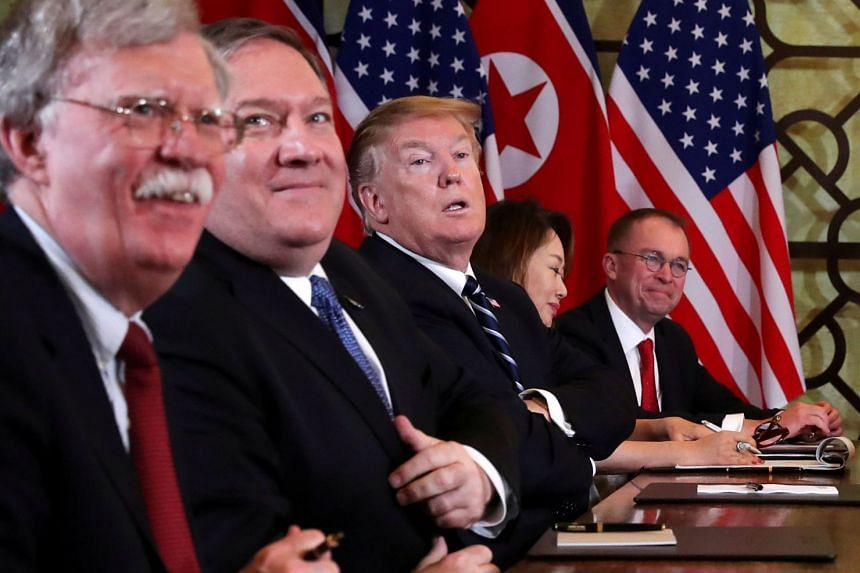 Bolton (far left) with US Secretary of State Mike Pompeo, Donald Trump and acting White House Chief of Staff Mick Mulvaney at a meeting with North Korea's leader Kim Jong Un and his delegation in Vietnam on Feb 28, 2019.