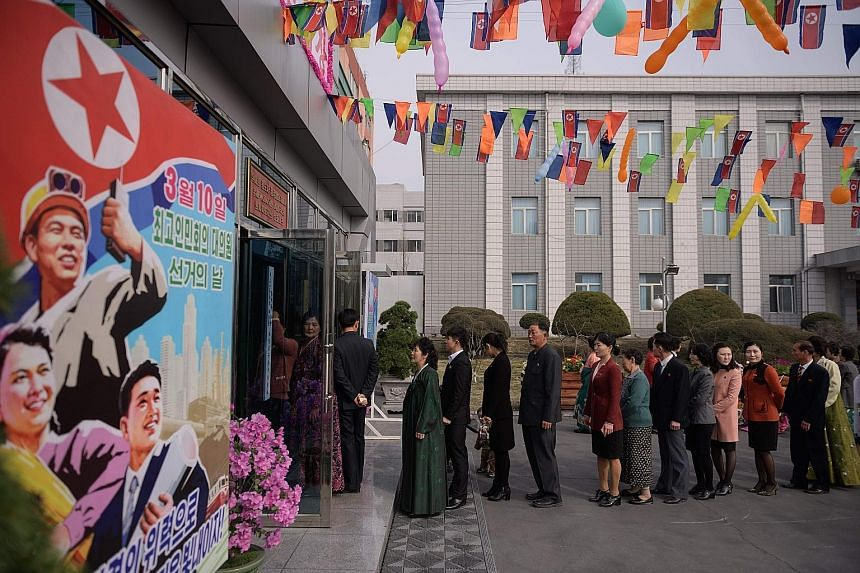 Voters queueing to cast their ballots at a voting centre in Pyongyang.