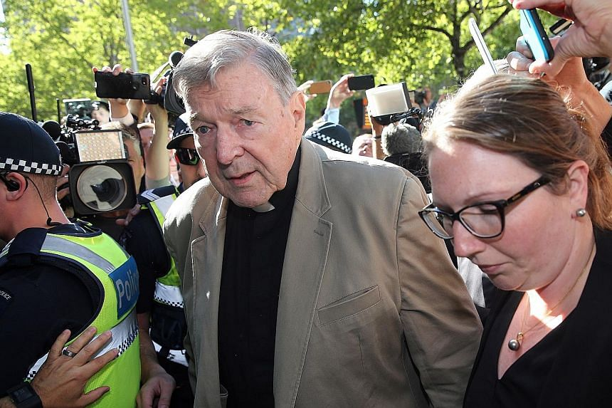 """Archbishop William Goh (above) last September addressed the disquiet over the scandals overseas, during which he said there has been no """"cover-up"""" in the Archdiocese of Singapore. Australian Cardinal George Pell (right), the No. 3 man in the Vatican,"""