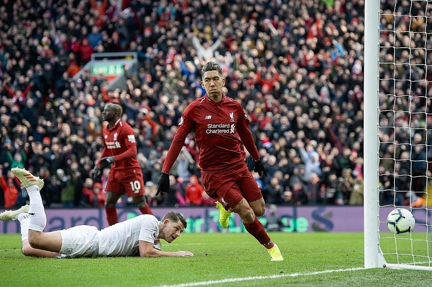 Liverpool forward Roberto Firmino celebrating his second and the Reds' third goal in the 4-2 victory over Burnley at Anfield yesterday. The Brazilian and teammate Sadio Mane each scored a brace to help the Reds overcome a controversial opener from th