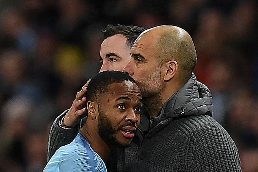 Manchester City's Raheem Sterling gets a hug from his manager as he is substituted after scoring a hat-trick.