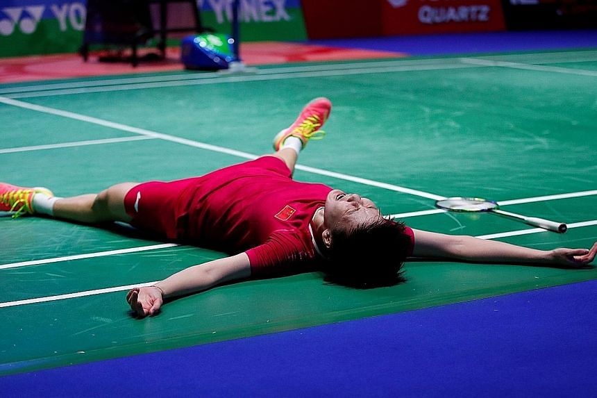 China's Chen Yufei is overcome with emotion and fatigue after beating her Chinese Taipei opponent Tai Tzu-ying in the women's singles final of the All England Open championships played at Arena Birmingham yesterday. The Chinese third seed beat the to