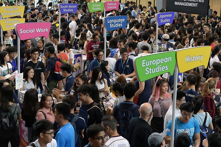 Prospective students at an open house at the National University of Singapore at the weekend. The intake for its School of Computing nearly doubled from about 500 in 2015 to 1,000 last year. A similar number of students is expected for this year's in