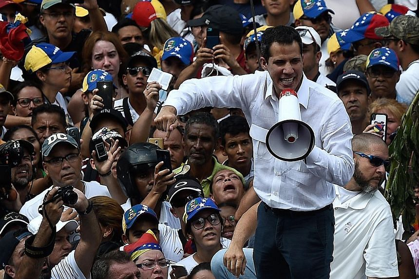 Opposition leader Juan Guaido speaking at a rally in Caracas on Saturday. A massive blackout since Thursday has crippled Venezuela and fuelled a political stand-off between Mr Guaido and embattled President Nicolas Maduro, who is clinging to power.