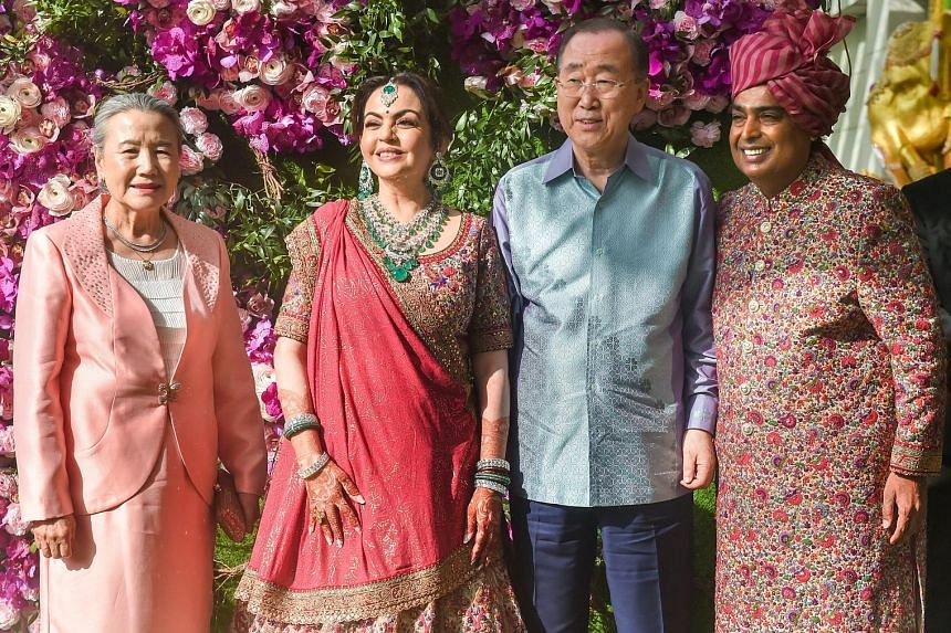 Indian businessman Mukesh Ambani and his wife Nita Ambani taking a photo with their guests, former United Nations secretary-general Ban Ki-moon and his wife Yoo Soon-taek, during the wedding ceremony of their son Akash Ambani and Ms Shloka Mehta. Act