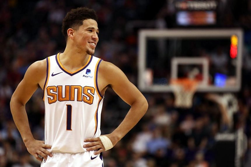 Phoenix guard Devin Booker made all nine of his free throws and had 11 assists in a match against the Golden State Warriors on March 10, 2019.