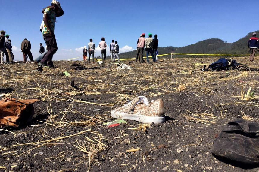 People at the scene of the Ethiopian Airlines Flight ET 302 plane crash, near the town of Bishoftu, south-east of Addis Ababa, Ethiopia, on March 10, 2019.