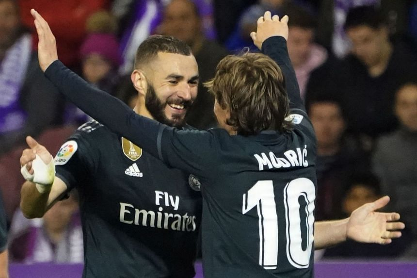 Real's Luka Modric (right) celebrates his goal with Karim Benzema.