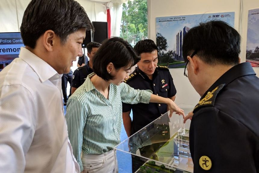 Mr Ng Chee Meng (left) and Ms Sun Xueling looking at a model of the upcoming Punggol fire station and neighbourhood police centre.