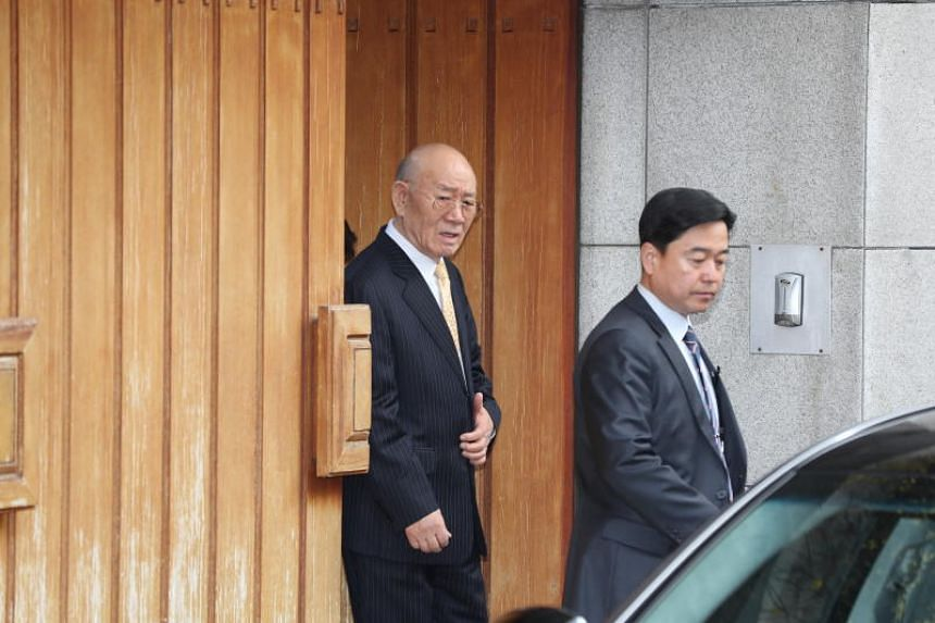 Former South Korean President Chun Doo-hwan (left) leaving his house in Seoul, South Korea on March 11, 2019.