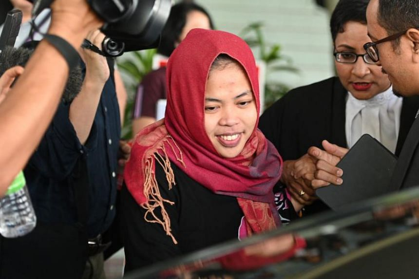 Indonesian national Siti Aisyah smiles while leaving the Shah Alam High Court, outside Kuala Lumpur on March 11, 2019, after her trial for her alleged role in the assassination of Kim Jong Nam, the half-brother of North Korean leader Kim Jong Un.