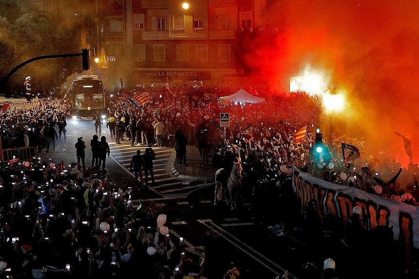 Hundreds of passionate Valencia supporters gathering outside the Mestalla stadium last month to welcome the team bus before their King's Cup semi-final second leg against Real Betis. They won 3-2 on aggregate and will play Barcelona in the final in M