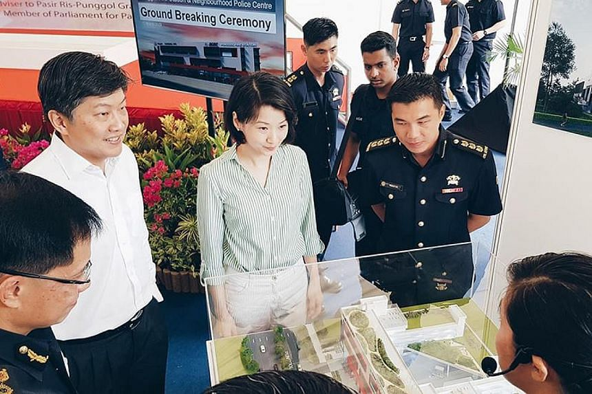 Mr Ng Chee Meng (left) and Ms Sun Xueling, both MPs for Pasir Ris-Punggol GRC, at the ground-breaking ceremony for the building which will house Punggol's fire station and police centre yesterday.