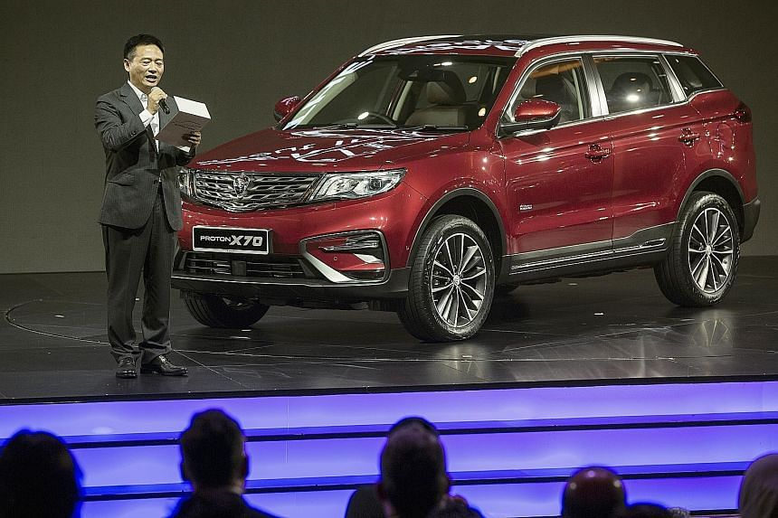 Proton chief executive Li Chunrong announcing prices of the Proton X70 sport utility vehicle during its launch last December.