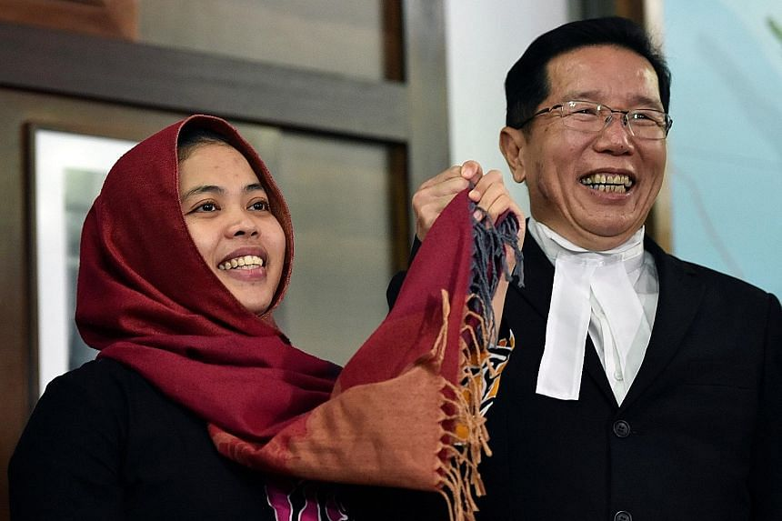 "Above: Ms Siti Aisyah with her lawyer Gooi Soon Seng at the Indonesian Embassy in Kuala Lumpur after she was freed yesterday. Attorney-General Tommy Thomas said she was released after ""taking into account the good relations"" between the two countries"