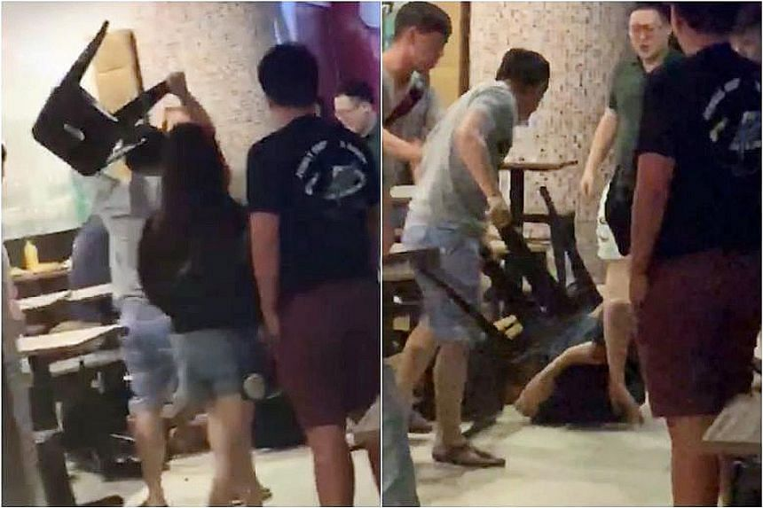 A video of the fight shows a man curled up on the floor of Liang Court's foodcourt while being beaten by two others. One of the men then uses a stool to hit the man on the floor.
