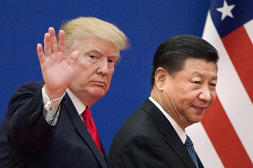 US President Donald Trump and China's President Xi Jinping leaving a business leaders event at the Great Hall of the People in Beijing on Nov 9, 2017.