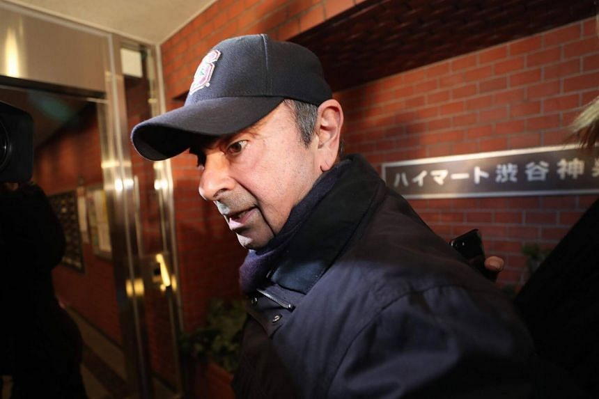 Former Nissan chairman Carlos Ghosn arrives at his residence in Tokyo, on March 8, 2019.