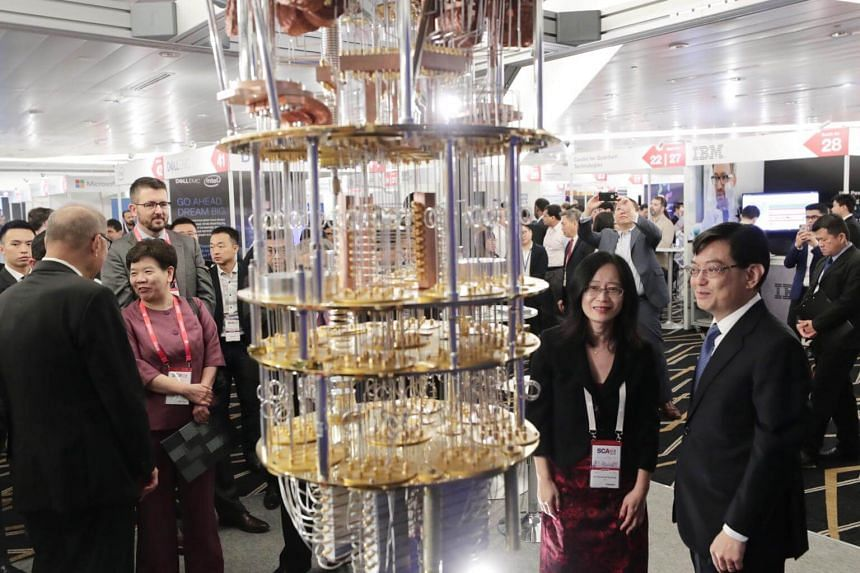Finance Minister Heng Swee Keat (right) looking at a universal quantum computer model on display at Supercomputing Asia 2019 on March 12, 2019.
