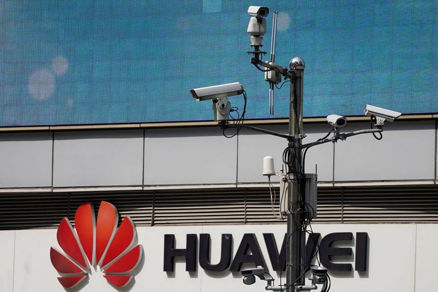 Surveillance cameras seen next to a Huawei company logo outside a shopping mall in Shanghai, China, on March 7, 2019.