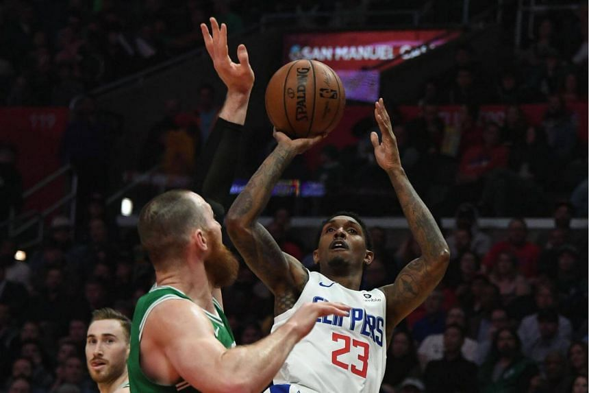 Los Angeles Clippers guard Lou Williams (in white) shoots the ball during game against the Boston Celtics, on March 11, 2019.