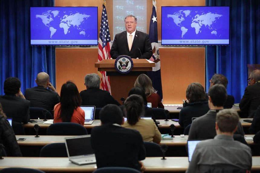 US Secretary of State Mike Pompeo holds a news conference to talk about the dire economic and political situation in Venezuela at the Harry S. Truman State Department headquarters in Washington, DC, on March 11, 2019.