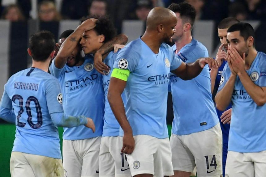Manchester City's Leroy Sane is congratulated by teammates after scoring a goal during the Uefa Champions League round of 16 first leg football match between Schalke 04 and Manchester City in Gelsenkirchen, Germany, on Feb 20, 2019.