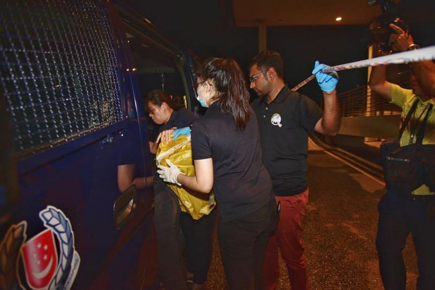 Investigators taking away items from the crime scene in Sungei Kadut Loop on March 11, 2019.