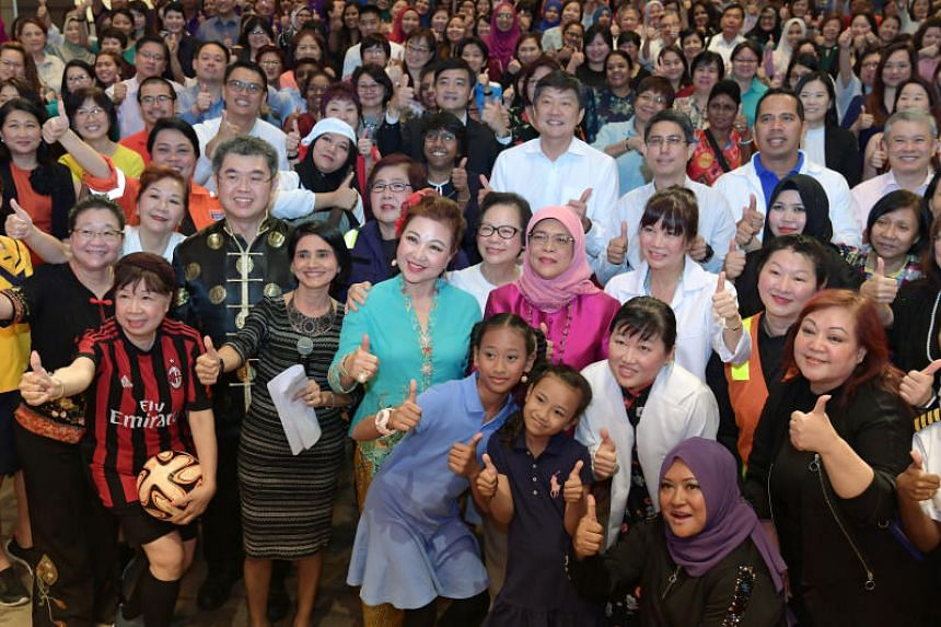 The National Trades Union Congress  announced the initiative at a forum commemorating International Women's Day that attracted about 300 union leaders, with President Halimah Yacob (in pink) giving the opening address.