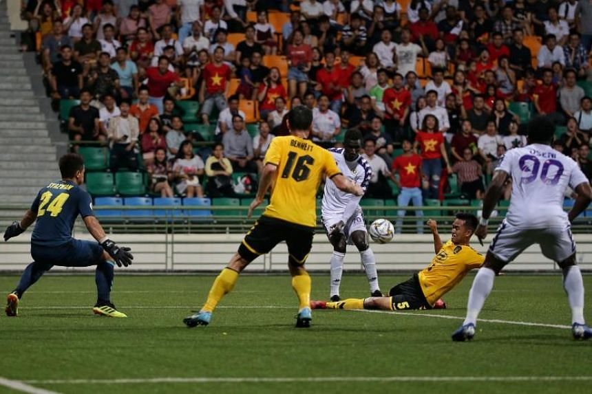 Tampines Rovers' Muhammad Amirul Adli Azmi (second from right) thwarting an attempt on goal by Hanoi FC's Pape Omar Faye during an AFC Cup match at Jalan Besar Stadium on Mar 12, 2019.