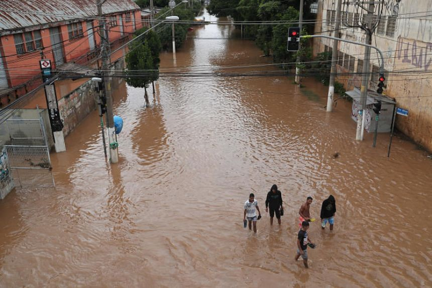 Intense floods turned roads in Sao Paulo into rivers, causing chaos in the city's already clogged traffic, as commuter trains were partially shut down, and buses and cars were stuck in gridlocked streets.