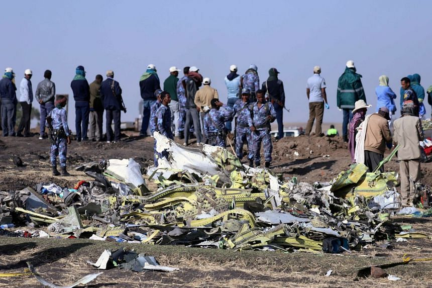 Ethiopian federal policemen at the scene of the plane crash yesterday. The country's Parliament declared a national day of mourning yesterday amid a global stream of condolences, including from UN Secretary-General Antonio Guterres, who said he was '