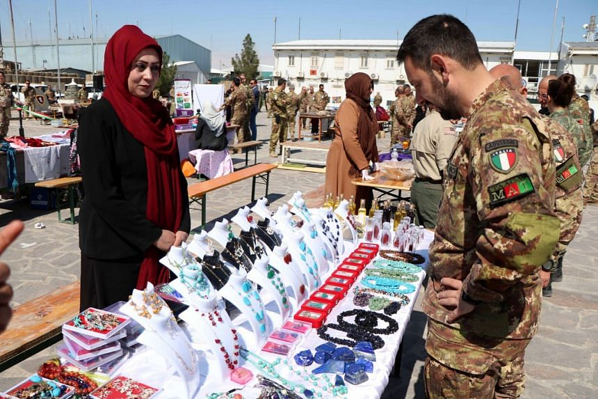 Afghan women display their handmade items at an exhibition organised by Italian soldiers of Nato Resolute Support Mission in Herat, Afghanistan.