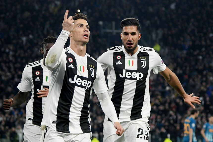 Juventus' Cristiano Ronaldo celebrates scoring their third goal to complete his hat-trick with Emre Can.