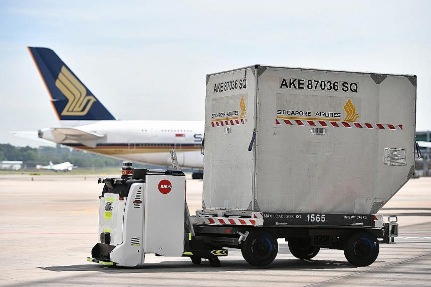An Autonomous Guided Vehicle with a container trailer at Changi Airport. At the new Changi East industrial complex, air freight terminals will be highly automated and data-driven.
