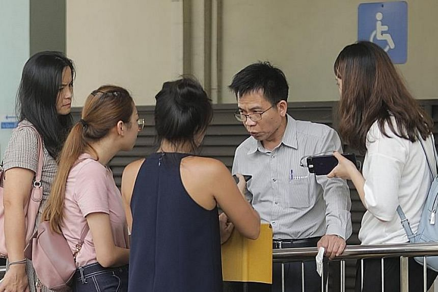 The father of Mr Lin Xinjie, the victim, speaking to the media at the Singapore General Hospital mortuary yesterday. The younger Mr Lin died on Monday after he was allegedly attacked by an employee of his company, Jiji Singapore.