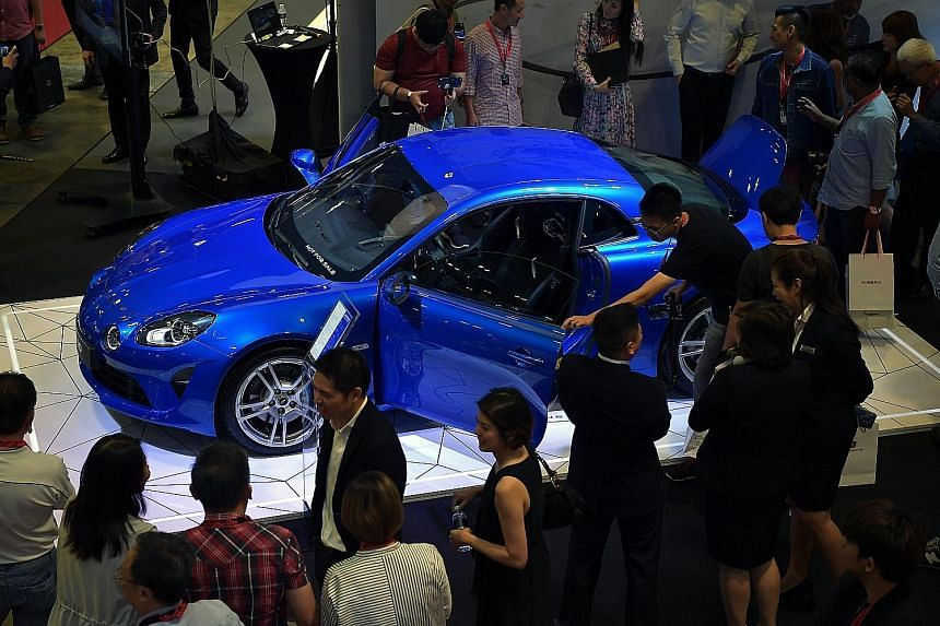The Singapore Motorshow in January helped boost car sales for the month, up 20 per cent from last year, noted SingStat.