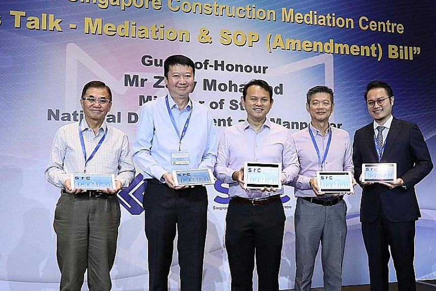 Marking the centre's launch yesterday were (from left) Singapore Construction Mediation Centre (SCMC) workgroup chairman Jason Tay, Singapore Contractors Association (SCAL) president Kenneth Loo, Minister of State for Manpower and National Developmen